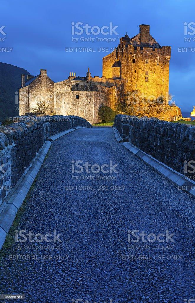 Scotland Eilean Donan castle illuminated against the blue dusk Highlands royalty-free stock photo