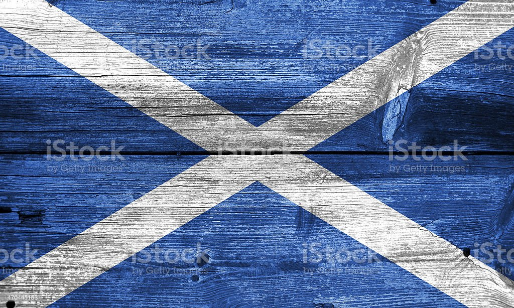 Scotland Flag painted on old wood plank texture stock photo