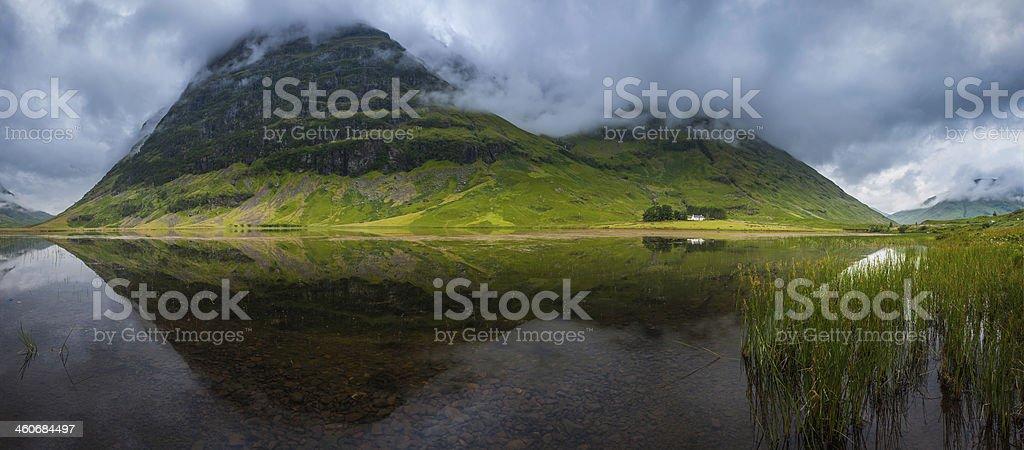 Scotland Glen Coe misty mountain loch picturesque Highlands panorama UK stock photo