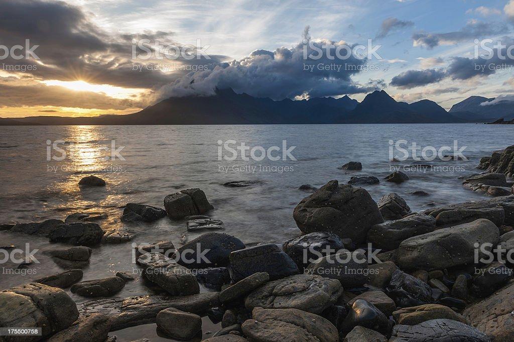 Scotland glorious sunset over mountain beach Skye stock photo