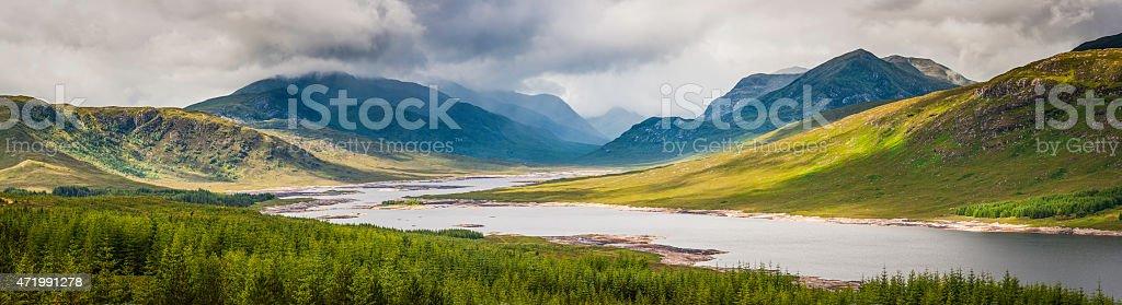 Scotland Highlands panoramic vista over mountain peaks green glen loch stock photo