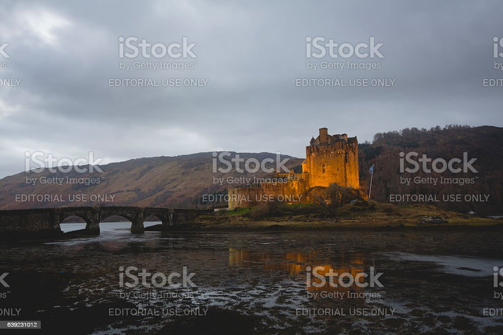Scotland iconic Highlands glen battlements of Eilean Donan castle illuminated stock photo