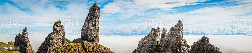 Scotland Isle of Skye Old Man of Storr overlooking clouds stock photo