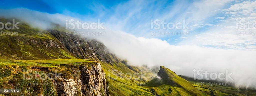 Scotland mist rolling over green Highlands mountain panorama Quiraing Skye stock photo