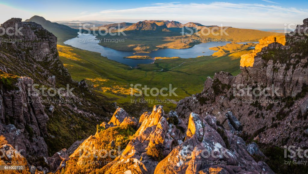 Scotland mountain sunrise over remote Highland peaks glens lochs Coigach stock photo
