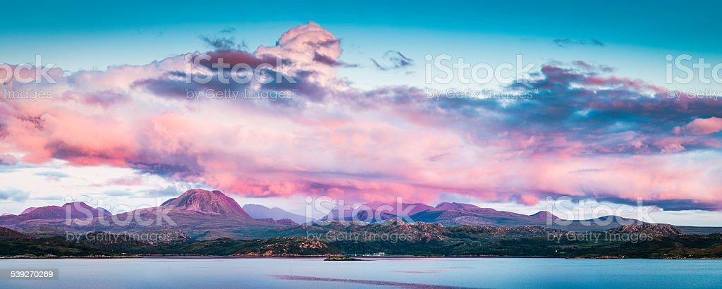 Scotland pink sunset over Gairloch Torridon mountain peaks panorama Highlands stock photo