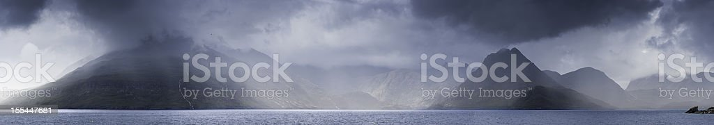 Scotland storm clouds over Cuillin mountains Skye stock photo