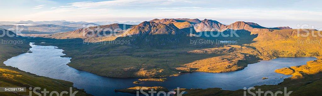 Scotland sunrise Highland mountain peaks wilderness overlooking loch glen panorama stock photo
