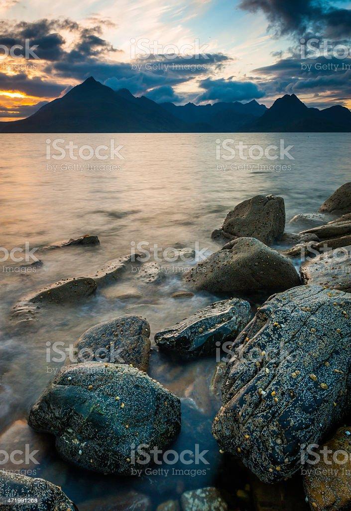 Scotland sunset over dramatic Cuillin mountain peaks Elgol beach Skye stock photo