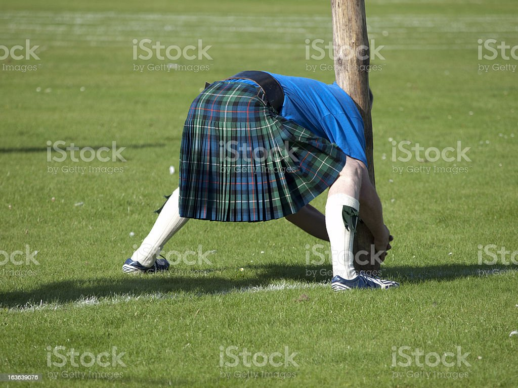 Scotsman preparing for a caber toss stock photo