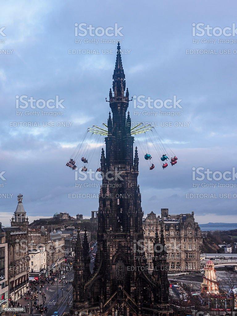 Scott monument, Edinburgh with fairground ride. stock photo