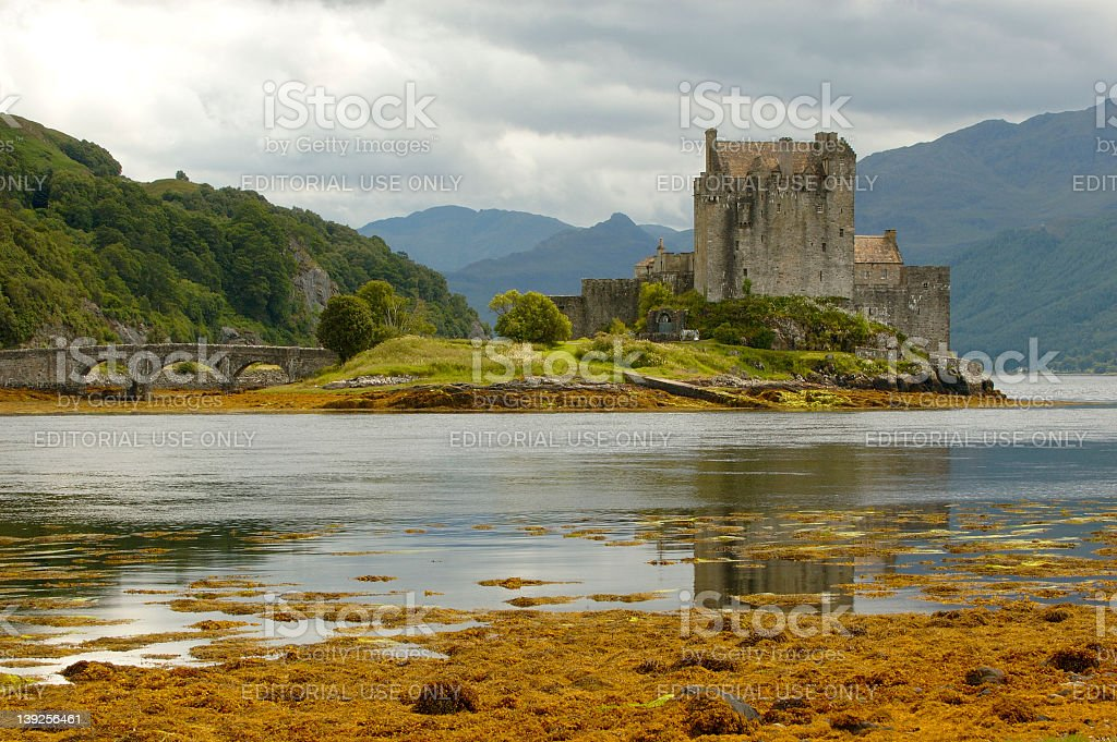 A Scottish castle beside a body of water stock photo