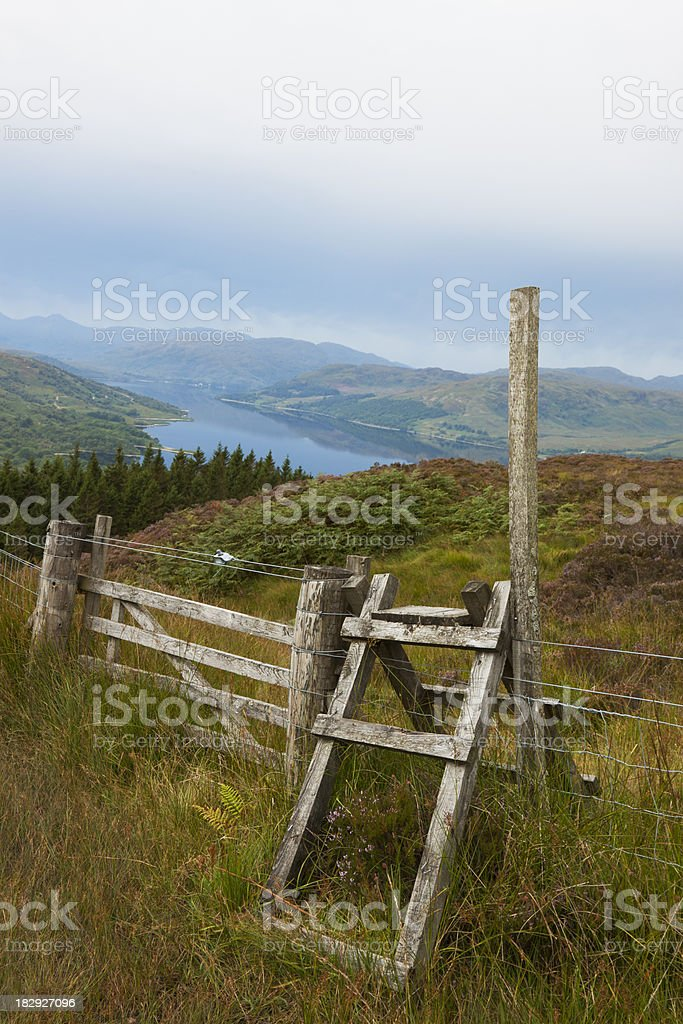 Scottish Countryside view of wooden stile over a fence. stock photo