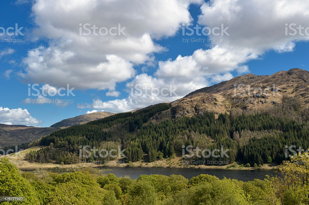 Scottish countryside with hills, woodland and a loch stock photo