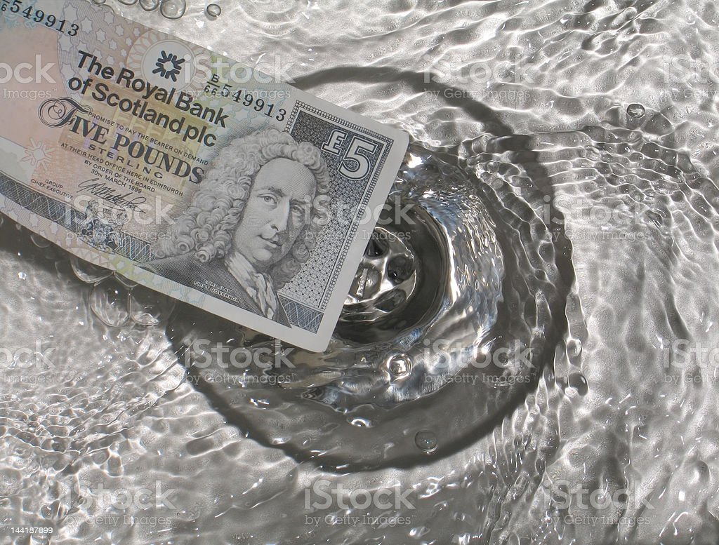 Scottish five-pound note and plughole stock photo