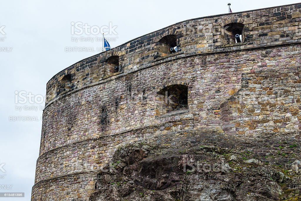 Scottish flag flying over castle walls stock photo