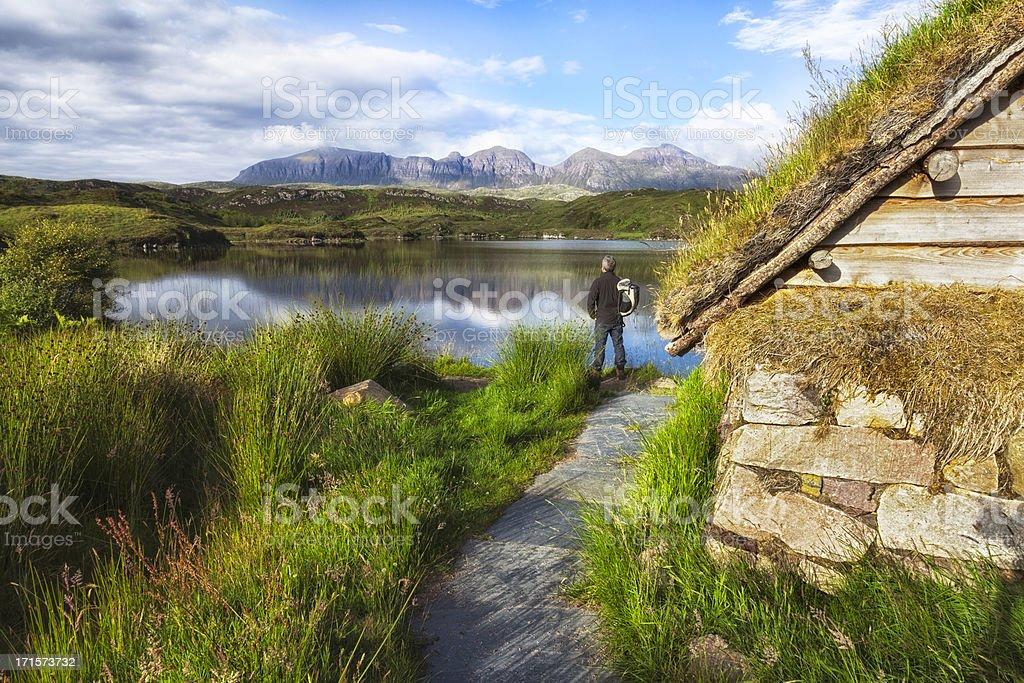 Scottish Highlands: Hiker looking at Quinag mountains royalty-free stock photo
