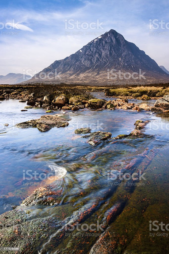Scottish highlands landscape scene with mountain and river royalty-free stock photo