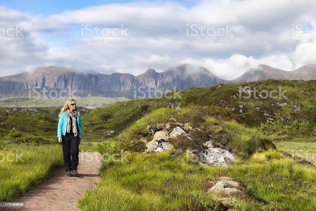 Scottish Highlands:Female hiker in front of Quinag mountains stock photo