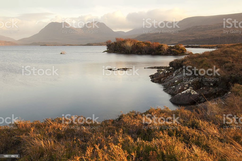 Scottish loch in the highlands at sunset royalty-free stock photo