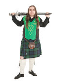 Scottish man in traditional national costume with sword