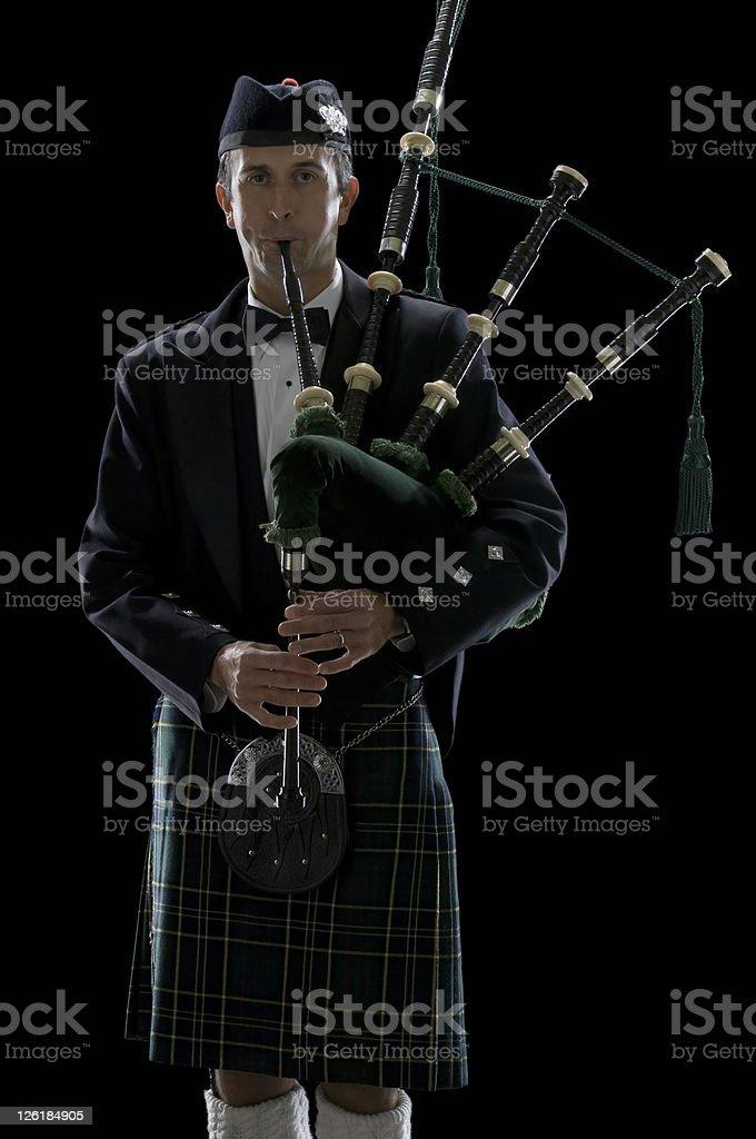 Scottish Man Playing Bagpipes stock photo