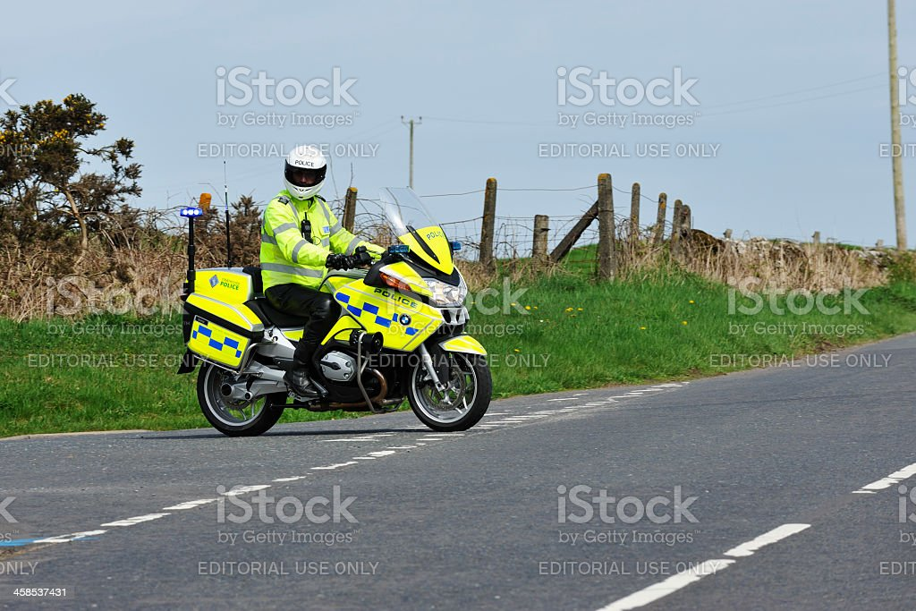 Scottish motorcycle policeman on a rual road stock photo