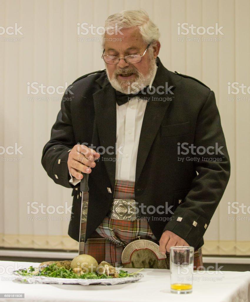Scottish Robbie Burns Evening  kilted Scotsman leading the tribute stock photo