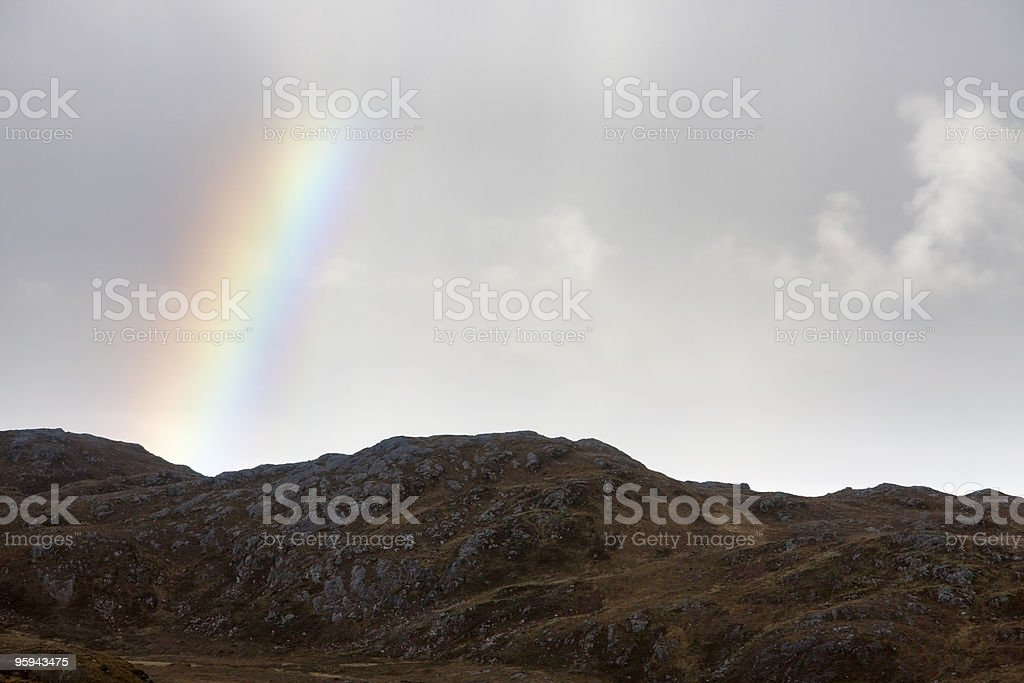 scottish scenery with rainbow and clouds royalty-free stock photo