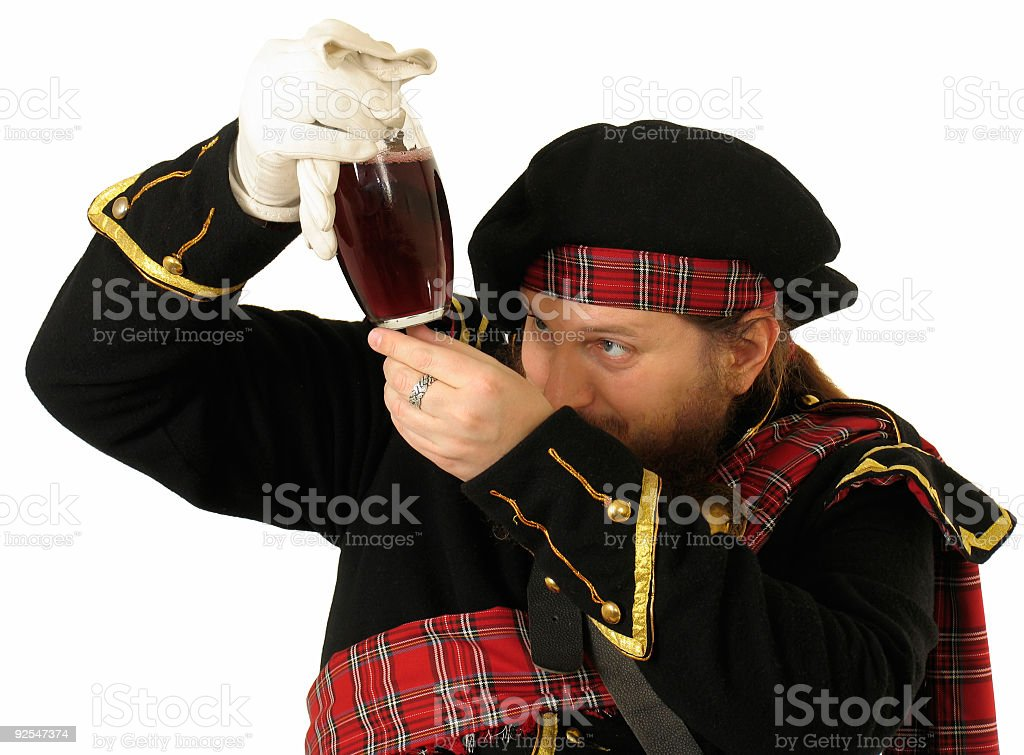 Scottish warrior with the bottle of red wine royalty-free stock photo