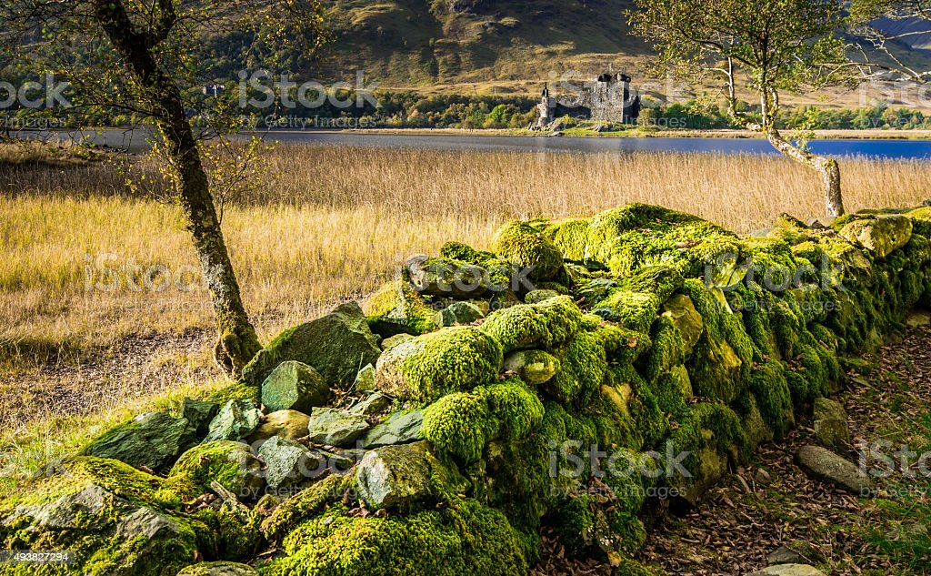 ScottishCastle with Loch an old wall. stock photo