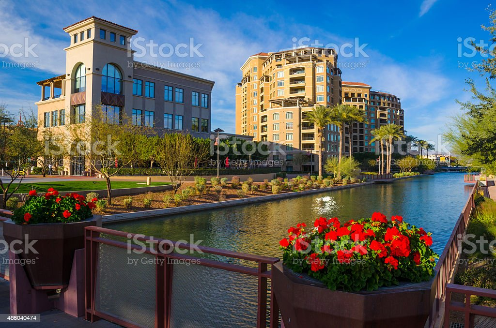 Scottsdale Arizona downtown buildings, canal, and flowers stock photo