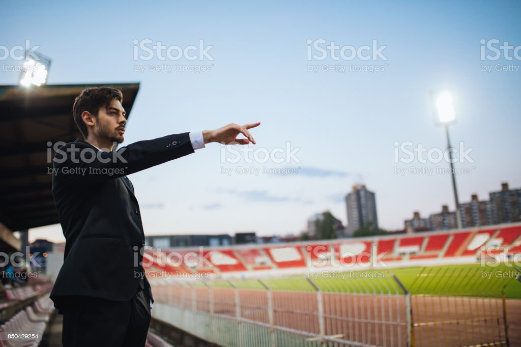 Scout standing on stadium stock photo