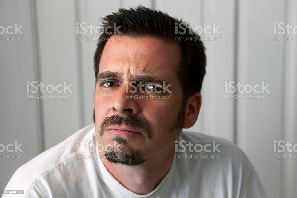 Scowling Man With Goatee stock photo