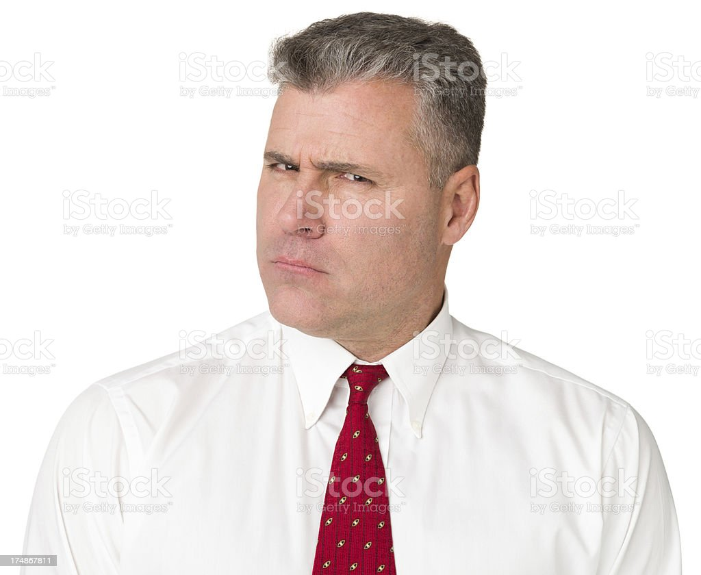 Scowling Mature Man In Shirt And Tie Looking At Camera royalty-free stock photo