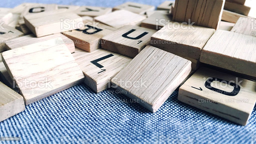 Scrabble Letter Tiles in a Messy Pile stock photo