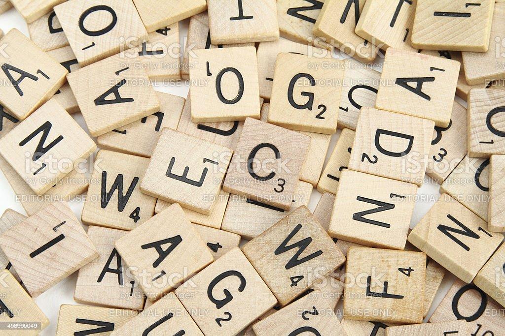Scrabble letter tiles scattered in random order royalty-free stock photo
