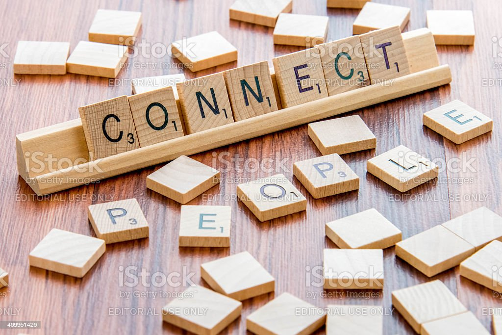 Scrabble Word Game wood tiles spelling CONNECT PEOPLE stock photo