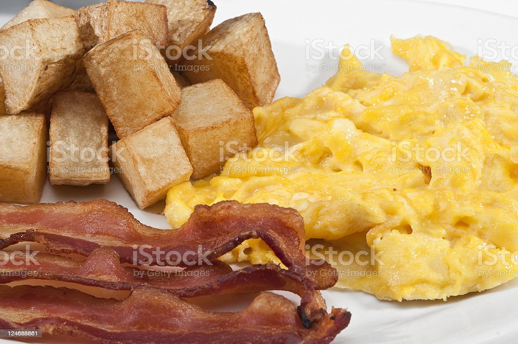 Scramble Eggs, bacon and fried potatoes royalty-free stock photo
