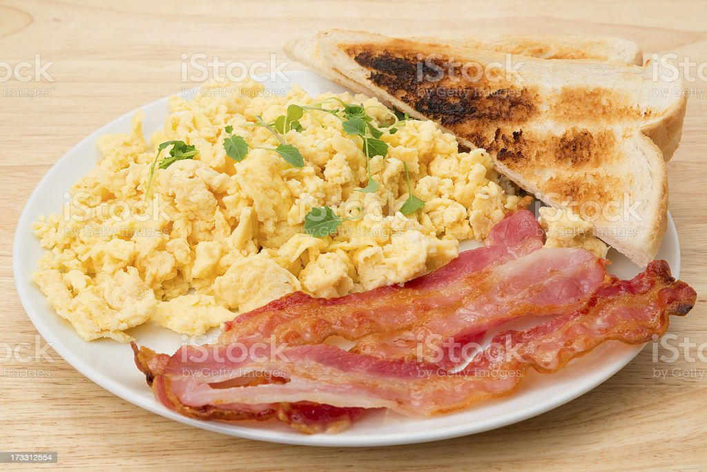 Scrambled egg and bacon breakfast with toast stock photo