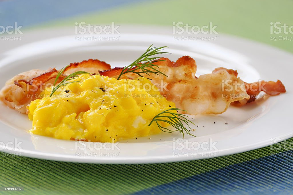 Scrambled egg and bacon stock photo