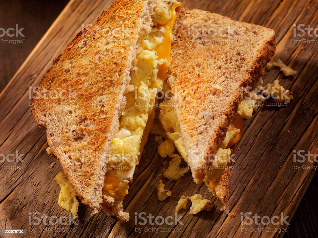 Scrambled Egg and Cheese Sandwich on Whole Grain Toast stock photo