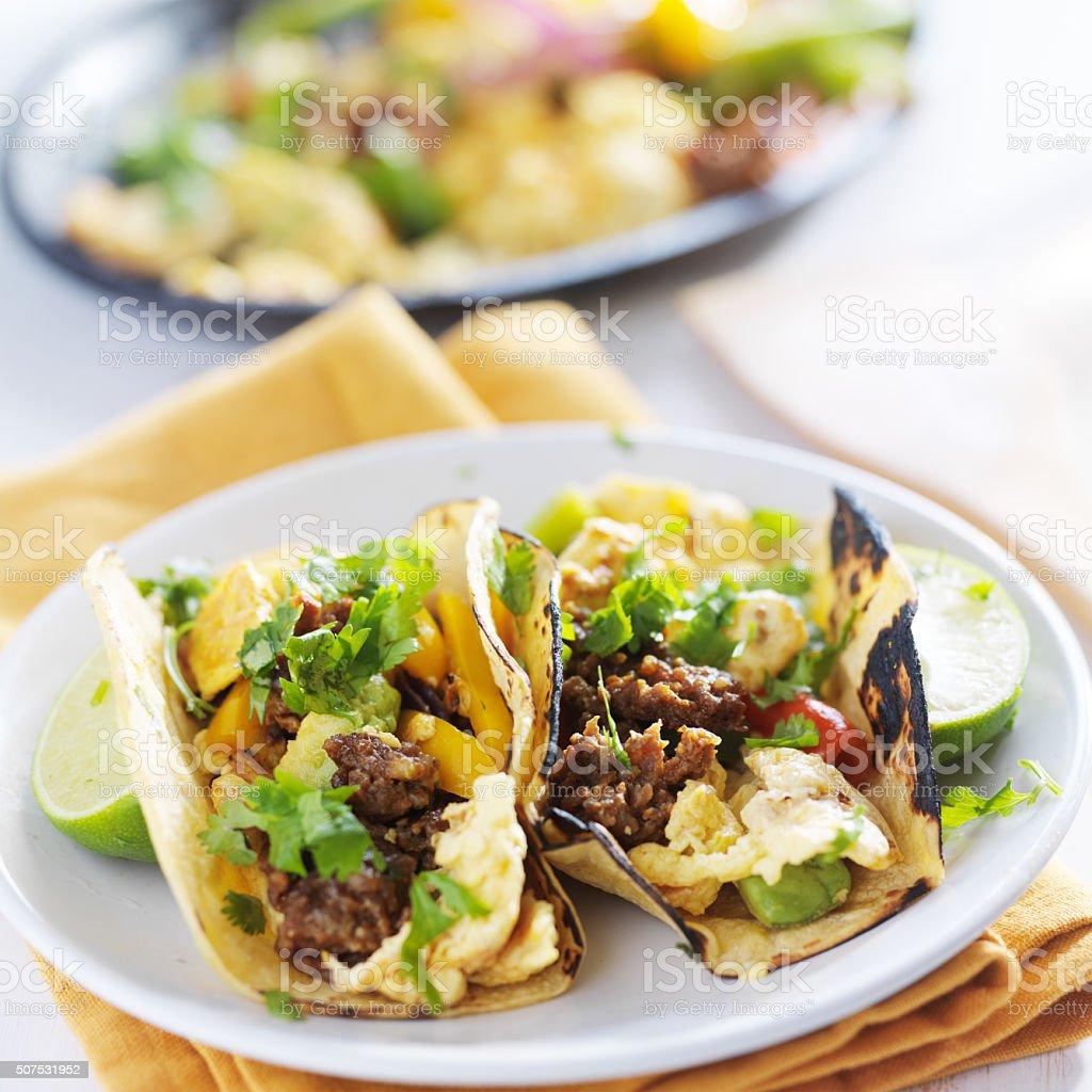 scrambled eggs and chorizo tacos stock photo