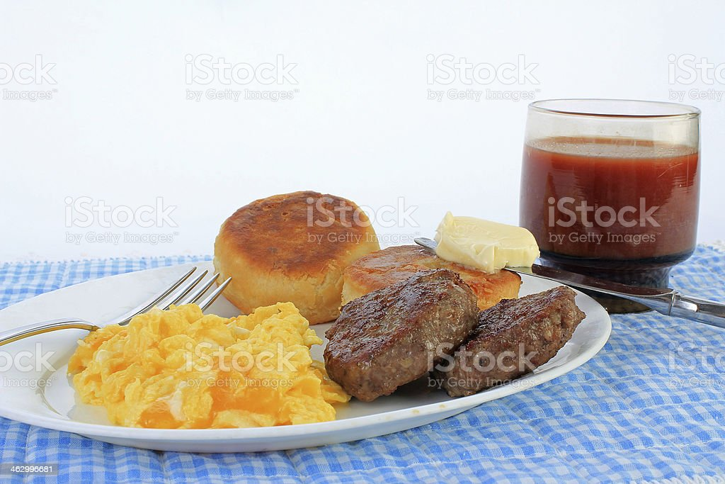 Scrambled Eggs and Sausage Patties stock photo