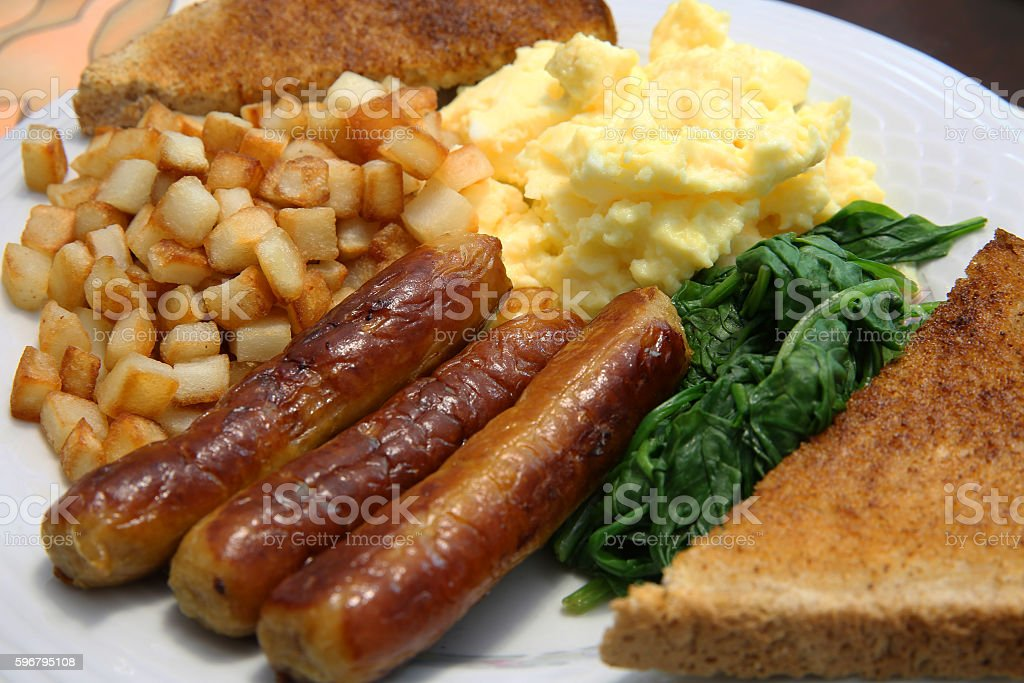 scrambled eggs and sausage stock photo