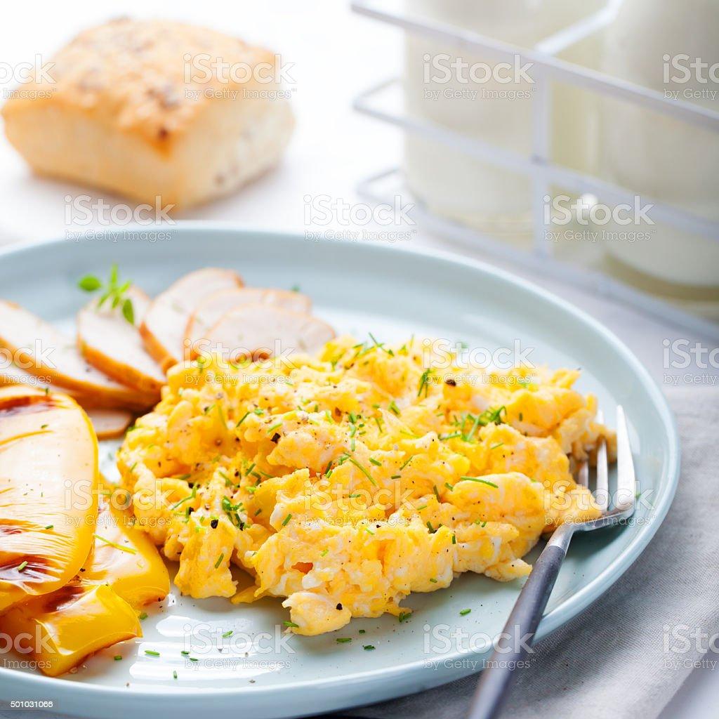 Scrambled eggs, omelet, pepper, smocked chicken stock photo