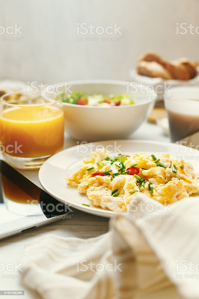 Scrambled Eggs on Breakfast Table Close-up stock photo