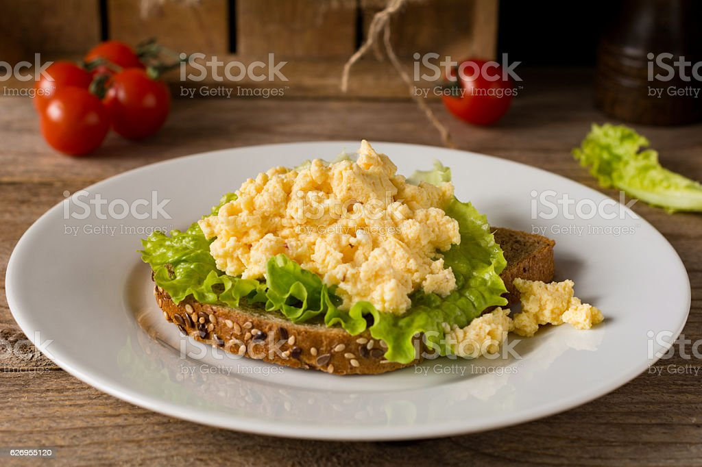 Scrambled eggs on toasted bread stock photo