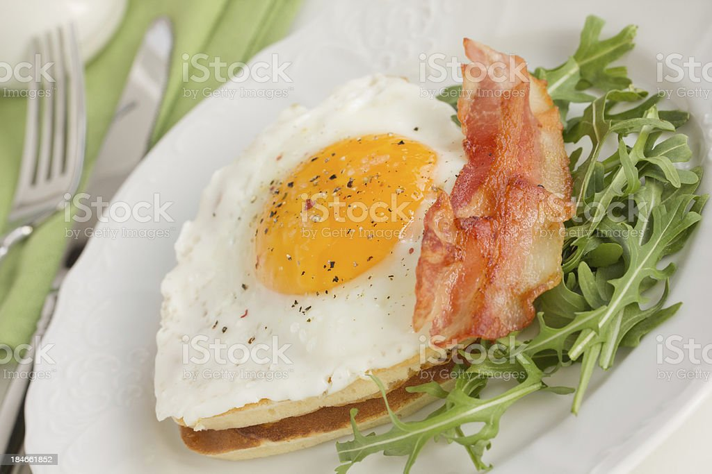 Scrambled eggs with bacon and arugula. royalty-free stock photo