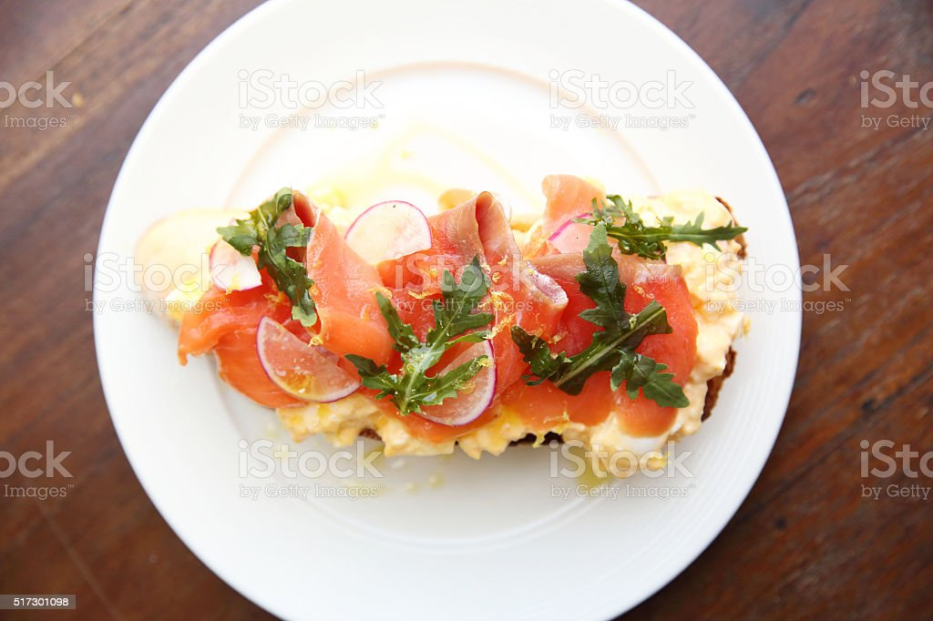 Scrambled Eggs With Smoked Salmon And Whole Wheat Toast Royalty Free Stock Photo